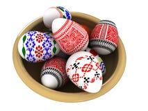 Пасхальные яйца на керамической тарелке. Стоковое Фото