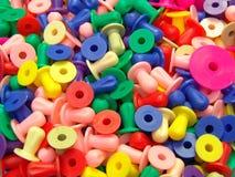 Покрашенные пластичные лепешки Стоковое фото RF