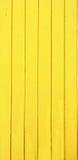 Покрашенные планки древесины желтый - вертикаль Стоковая Фотография