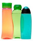 Покрашенные пластичные бутылки с жидкостным мылом и Стоковые Фото