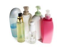 Покрашенные пластичные бутылки с batcher Стоковое Фото