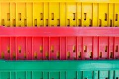 Покрашенные пластичные корзины штабелированы Стоковое фото RF