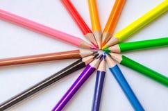 Покрашенные лучи карандаша на белой предпосылке Стоковые Фотографии RF