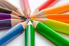 Покрашенные лучи карандаша на белой предпосылке Стоковая Фотография RF