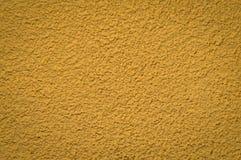 Покрашенный желтым цветом гипсолит внешней стены дома стоковые изображения