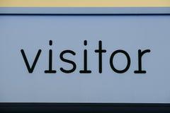 Покрашенный знак посетителя голубым стоковое фото rf