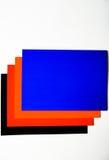 Покрашенный картон на белой предпосылке Стоковые Изображения