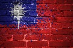 Покрашенный национальный флаг Тайваня на кирпичной стене Стоковое фото RF