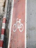 Покрашенный дорожный знак велосипеда Стоковая Фотография