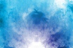Покрашенный порошок splatted на белой предпосылке Стоковое Фото