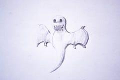 Покрашенный призрак на куске бумаги стоковое изображение rf