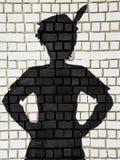 Покрашенный силуэт Питер Пэн на стене Стоковое Изображение RF