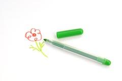 Покрашенный цветок и зеленая ручка войлок-подсказки Стоковое Фото