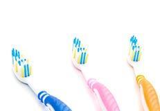 3 покрашенных зубной щетки на белизне Стоковое Изображение RF