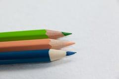 3 покрашенных карандаша на белой предпосылке Стоковое фото RF