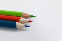3 покрашенных карандаша на белой предпосылке Стоковые Изображения