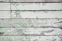 Покрашено слезать деревянные панели стоковые фото