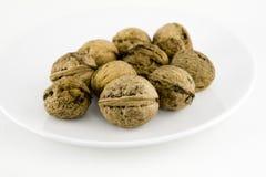 покройте некоторые грецкие орехи белые Стоковые Изображения RF