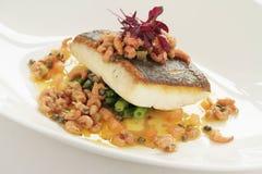 Покрытая еда рыб Стоковое Фото