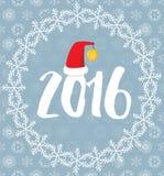 2016 покрытое с снежинками на снежной предпосылке Стоковое фото RF