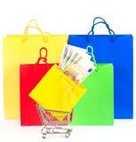 покупка принципиальной схемы наличных дег тележки мешков цветастая Стоковое Изображение