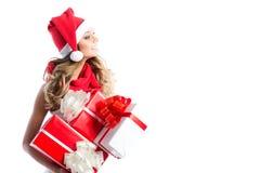 покупка рождества женщина santa удерживания шлема подарков Стоковое Фото