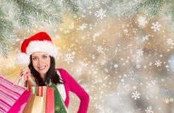 покупка рождества Счастливая маленькая девочка с хозяйственными сумками Стоковые Изображения