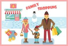 Покупки семьи зимы стоковые изображения