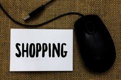 Покупки текста сочинительства слова Концепция дела для продуктов товаров приобретения клиента покупателя хранит пюре искусства мы стоковые фото