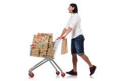 Покупки человека при изолированная тележка корзины супермаркета стоковое изображение