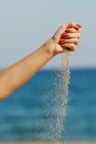 полейте песок Стоковые Фото