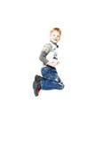 полет мальчика счастливый немногая Стоковая Фотография