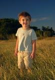 поле мальчика сиротливое Стоковое Изображение