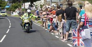Полицейский на мотовелосипеде стоковые фото