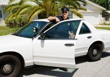 полиции офицера автомобиля стоковая фотография rf