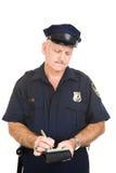 полиции стоянкы автомобилей офицера снабжают билетами Стоковые Фото