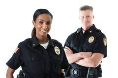 Полиция: Партнеры офицера стоя совместно стоковое фото