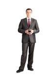 Полнометражный бизнесмен связи костюма стоковое фото rf