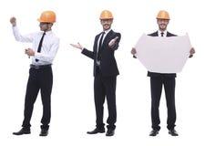 Полностью рост квалифицированный архитектор в оранжевом шлеме стоковая фотография rf