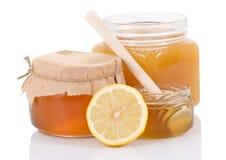 полным изолированная медом белизна бака лимона Стоковое Изображение RF