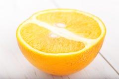 Половина апельсина на белой предпосылке Стоковое Изображение RF