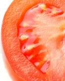половинный томат ломтика стоковые фото