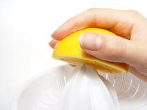 половинный juicer o руки Стоковая Фотография