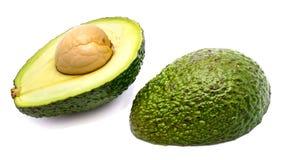 2 половины авокадоа изолированной на белой предпосылке Стоковое Изображение