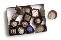 Половин-Съеденная коробка шоколадов стоковые фото