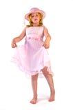 положение девушки платья розовое стоковое изображение