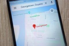 Положение Джорджтаун на Google Maps показало на современном смартфоне стоковое изображение