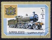 ПОЛОЖЕНИЕ AJMAN - ОКОЛО 1972: локомотив, серия, около 1972 стоковые изображения rf