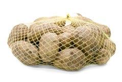 положенная в мешки картошка Стоковые Фото