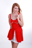 Положительная девушка в красном платье Стоковые Изображения